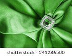 emerald ring on draped green... | Shutterstock . vector #541286500