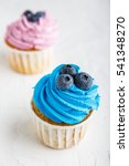 Two Delicious Cupcakes With...