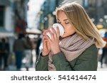 Girl Drink Coffee On The Street
