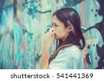 thoughtful woman alone outdoors....   Shutterstock . vector #541441369
