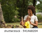 African American Mom Spending...