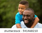 african american father and son | Shutterstock . vector #541468210