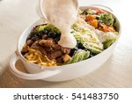 cobb salad with dressing | Shutterstock . vector #541483750