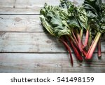 Rhubarb On A Wooden Background