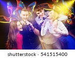 group of happy friends singing... | Shutterstock . vector #541515400