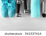 Small photo of Fitness equipment on wooden background