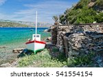Small photo of Small fishing boat on the aegean island Samos
