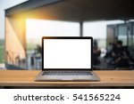 laptop with blank screen on... | Shutterstock . vector #541565224