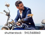man on motorcycle in suite | Shutterstock . vector #541568860