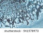 snow frosty pattern on glass | Shutterstock . vector #541578973