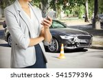woman using phone after car... | Shutterstock . vector #541579396