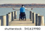 Young Man In Wheelchair With...