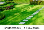 Pathway In Garden Green Lawns...
