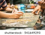 hand playing board game ... | Shutterstock . vector #541649293