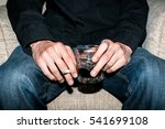man addict holding a glass of... | Shutterstock . vector #541699108