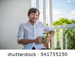 man drinking a mojito on the... | Shutterstock . vector #541755250