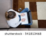 woman lying on floor and using... | Shutterstock . vector #541813468