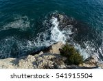 Waves Breaking Against Cliff ...