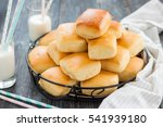 buns with milk on the table.... | Shutterstock . vector #541939180