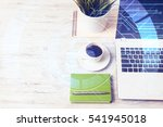 opened laptop and other office... | Shutterstock . vector #541945018