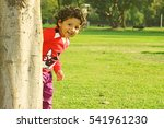 adorable happy kid with curly... | Shutterstock . vector #541961230