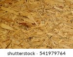 Small photo of texture of recycled paper with natural fiber parts, Wood agglomerate, detail of a wooden background texture