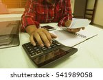 man using calculator calculate... | Shutterstock . vector #541989058
