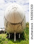 Small photo of Plane head wreckage sitting on the ground, taken on a sunny day, useful for plane safety, pilot, flights, air craft, aero space industry, travel, holiday, insurance related concepts