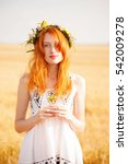 redhead girl at summer wheat... | Shutterstock . vector #542009278