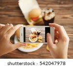 female hands taking photo of...   Shutterstock . vector #542047978