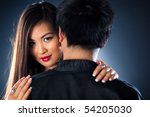 Young japan couple. Focus on woman face. - stock photo