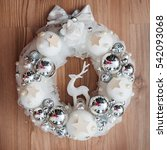 silver christmas wreath on wood ... | Shutterstock . vector #542093068