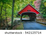 Red Covered Bridge In The Whit...