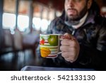 man with hot drink relaxing | Shutterstock . vector #542133130