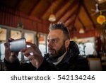 man  using a smart phone indoors | Shutterstock . vector #542134246