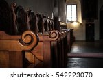 row of wooden benches inside a... | Shutterstock . vector #542223070