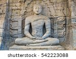 Small photo of Meditating Buddha in lotus position. Polonnaruwa. Gal Vihara. Sri Lanka