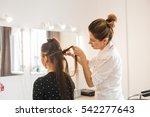 Hairdresser Doing Haircut For...