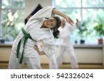 Small photo of Warm-up and stretching of muscles during training Aikido