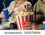 eating popcorn. cropped closeup ... | Shutterstock . vector #542379004
