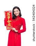 Small photo of Portrait of a beautiful Asian woman on traditional festival costume Ao Dai showing New Year scrolls Tet holiday. Lunar New Year. Text mean Always Lucky.