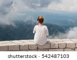 girl sitting on the mount... | Shutterstock . vector #542487103