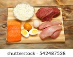 Small photo of sport, fitness, healthy lifestyle, diet and people concept - close up of natural protein food and additive on wooden table