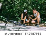Stock photo cyclists young couple walking in the park german shepherd 542487958