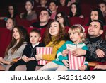 happy family in the movie | Shutterstock . vector #542511409