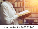 woman reading a book in front... | Shutterstock . vector #542521468