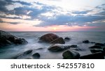 stone in the sea at sunset  | Shutterstock . vector #542557810