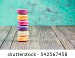 colorful macarons on vintage... | Shutterstock . vector #542567458