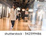 beautiful woman in trench coat... | Shutterstock . vector #542599486