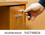 The Man Closes The Drawer Of...